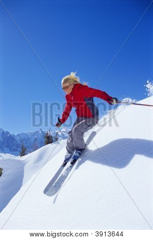 Woman Skiing Down Mountain