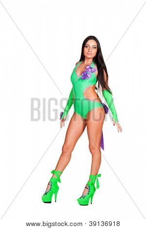 pretty go-go dancer in green costume posing over white background