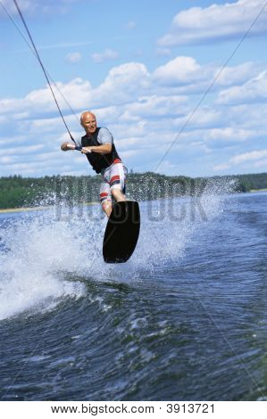 Man Doing Jump On Wakeboard