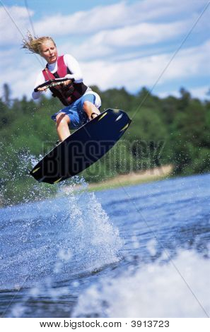 Woman Doing Jump On Wakeboard