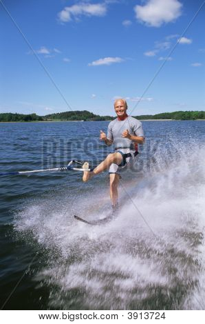 Man Water-Skiing On One Leg