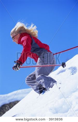 Woman Skiing On Mountain