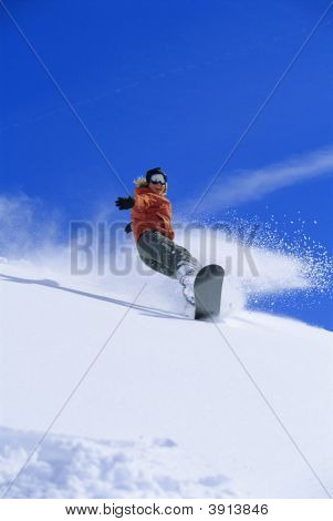 Woman Snowboarding Down Mountain