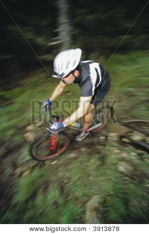 Man Biking Across Rough Terrain
