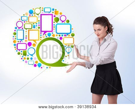 Young business woman presenting colourful speach bubble on bright background