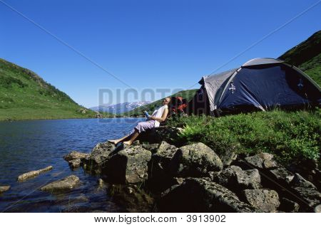 Woman Relaxing By River