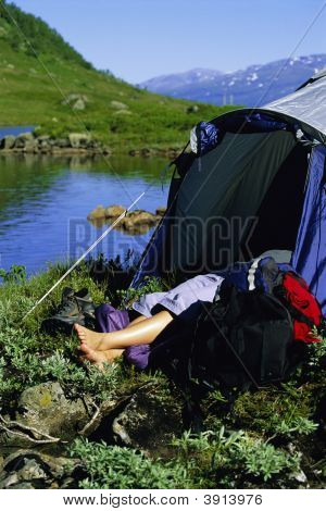 Woman Camping By River