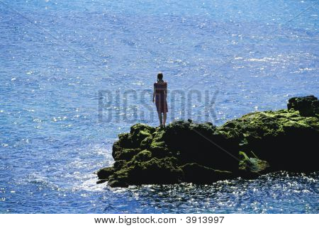 Woman Looking Out Over Ocean