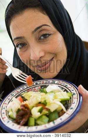 Middle Eastern Woman Eating Food