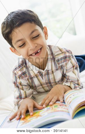 Middle Eastern Child Reading Book At Home