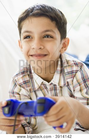poster of Middle Eastern Child Playing On Games Console At Home