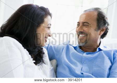 Middle Eastern Couple At Home On Sofa