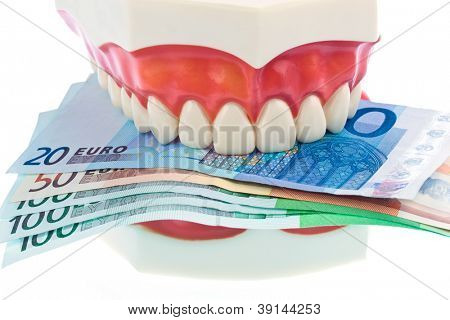 a dental model to the dentist with euro notes. costs for health.
