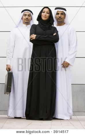 Middle Eastern Business Men And Woman Facing Camera