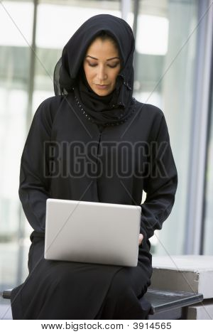 Middle Eastern Business Woman On Laptop