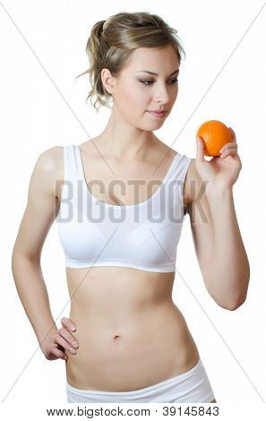 The beautiful girl with fresh Orange isolated
