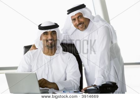 Middle Eastern Business Men At Desk With Laptop