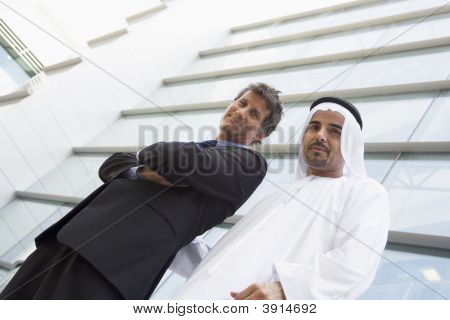 Middle Eastern And Western Business Men Standing In Front Of Offices