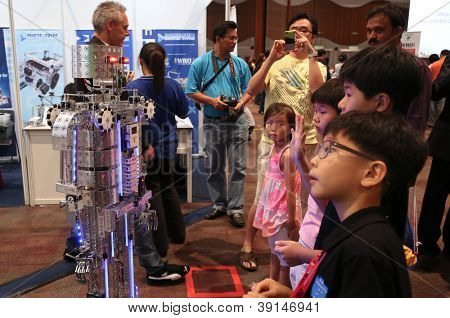 SUBANG JAYA - NOVEMBER 10: A robot performs for unidentified visitors at the World Robot Olympaid on November 10, 2012 in Subang Jaya, Malaysia. This year's theme is Robots connecting people.