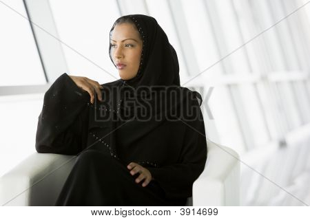 Middle Eastern Business Woman Waiting In Chair