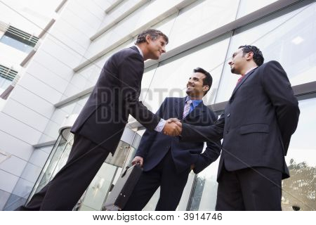 Middle Eastern / Western Business Men Stood Outside Offices
