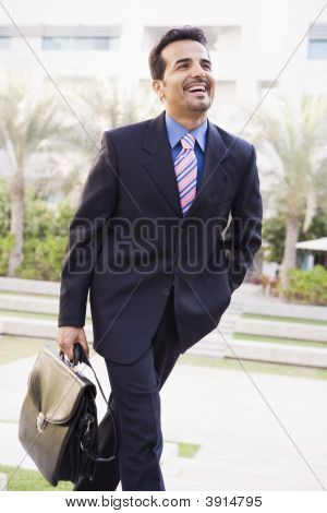 Middle Eastern Business Man On Way To Work