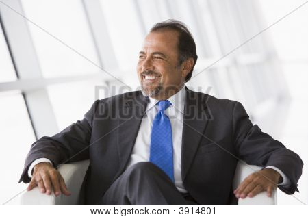 Middle Eastern Business Man Sat On Chair