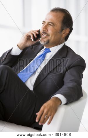 Middle Eastern Business Man Sat On Chair Using Cell Phone