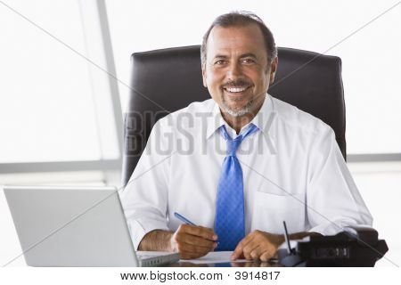 Middle Eastern Business Man At Desk With Laptop