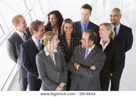 Middle Eastern / Western Business People Looking Up At Camera