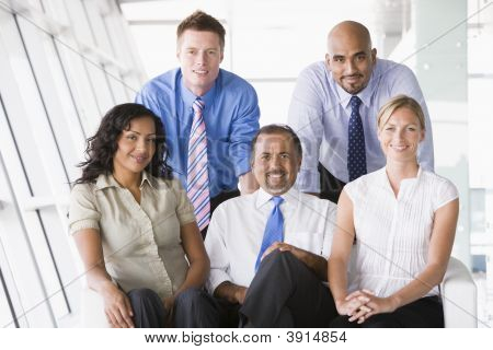 Middle Eastern / Western Business People Sat On Sofa