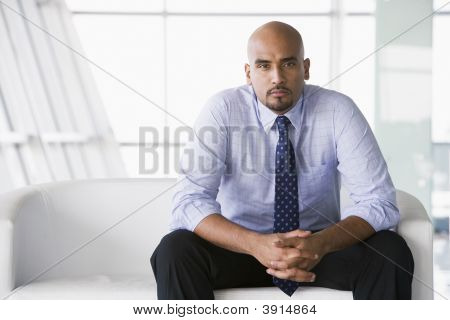 Middle Eastern Business Man Sat On Sofa