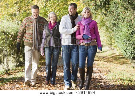 Generational Couples Walking Through Woodland