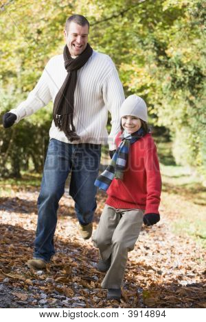 Child Leading Dad Through Woodland