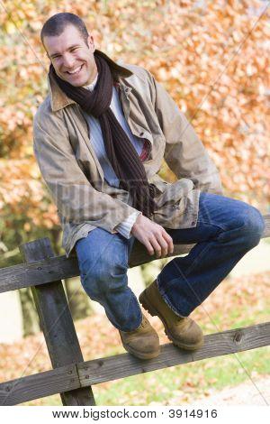Man Sat On Woodland Fence