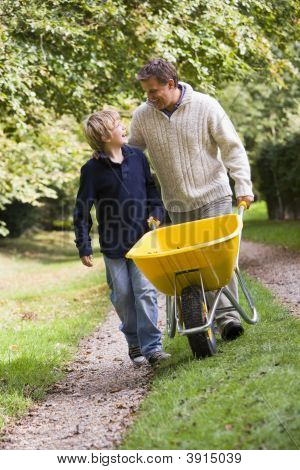 Man And Boy With Wheelbarrow