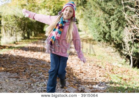 Child Running Through Woodland