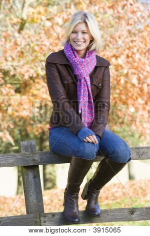 Woman Sat On Woodland Fence
