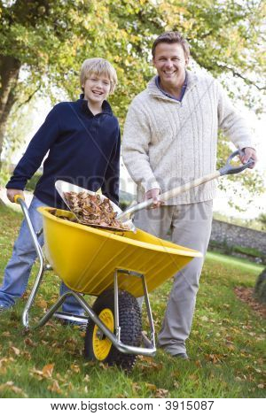 Man And Child Raking Leaves