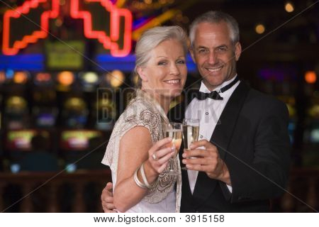 Couple In Casino With Champagne