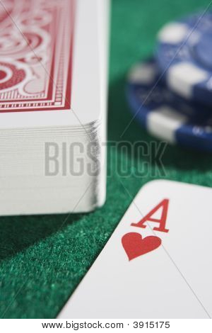 Close Up Of Gambling Chips And Cards