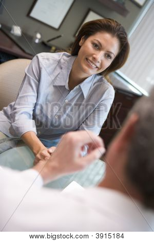 Woman Discussing Ivf Treatment With Doctor