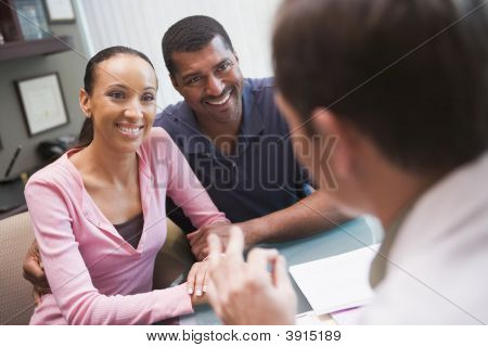 Couple Discussing Ivf Treatment With Doctor