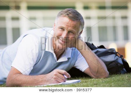 Senior Man Studying Outsdie School