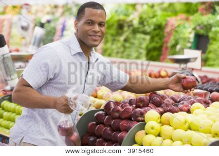 Man Choosing Fruit In Shop