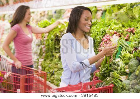 Women Choosing Vegetables In Shop