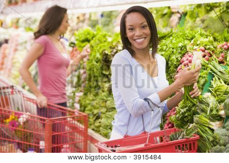 Women Choosing Vegetables In Shop
