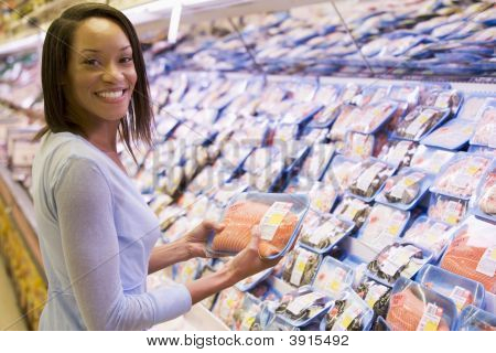 Woman Choosing Meat From Shop