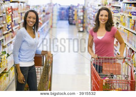 Women Chatting In Supermarket