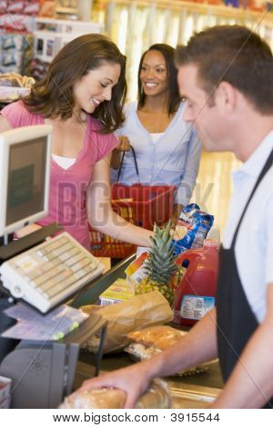 Woman Buying Shopping At Supermarket